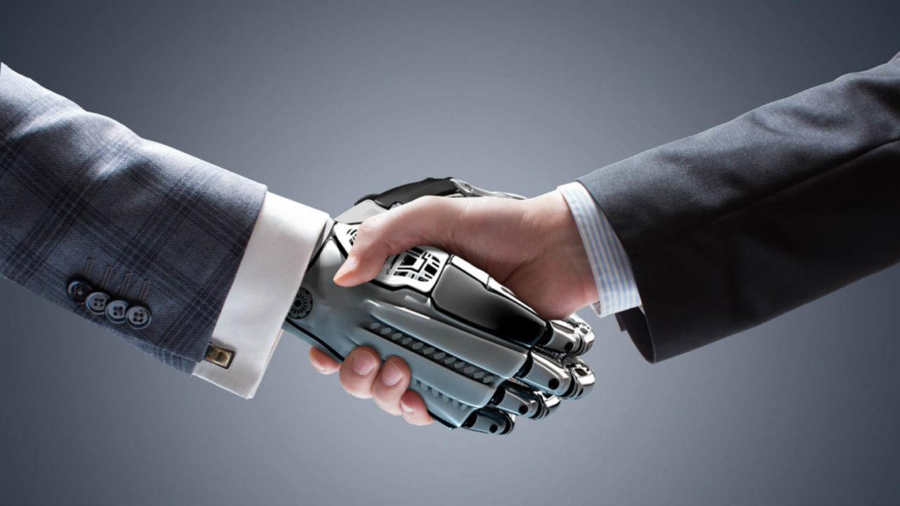Man-shaking-hands-with-robot-1280×720